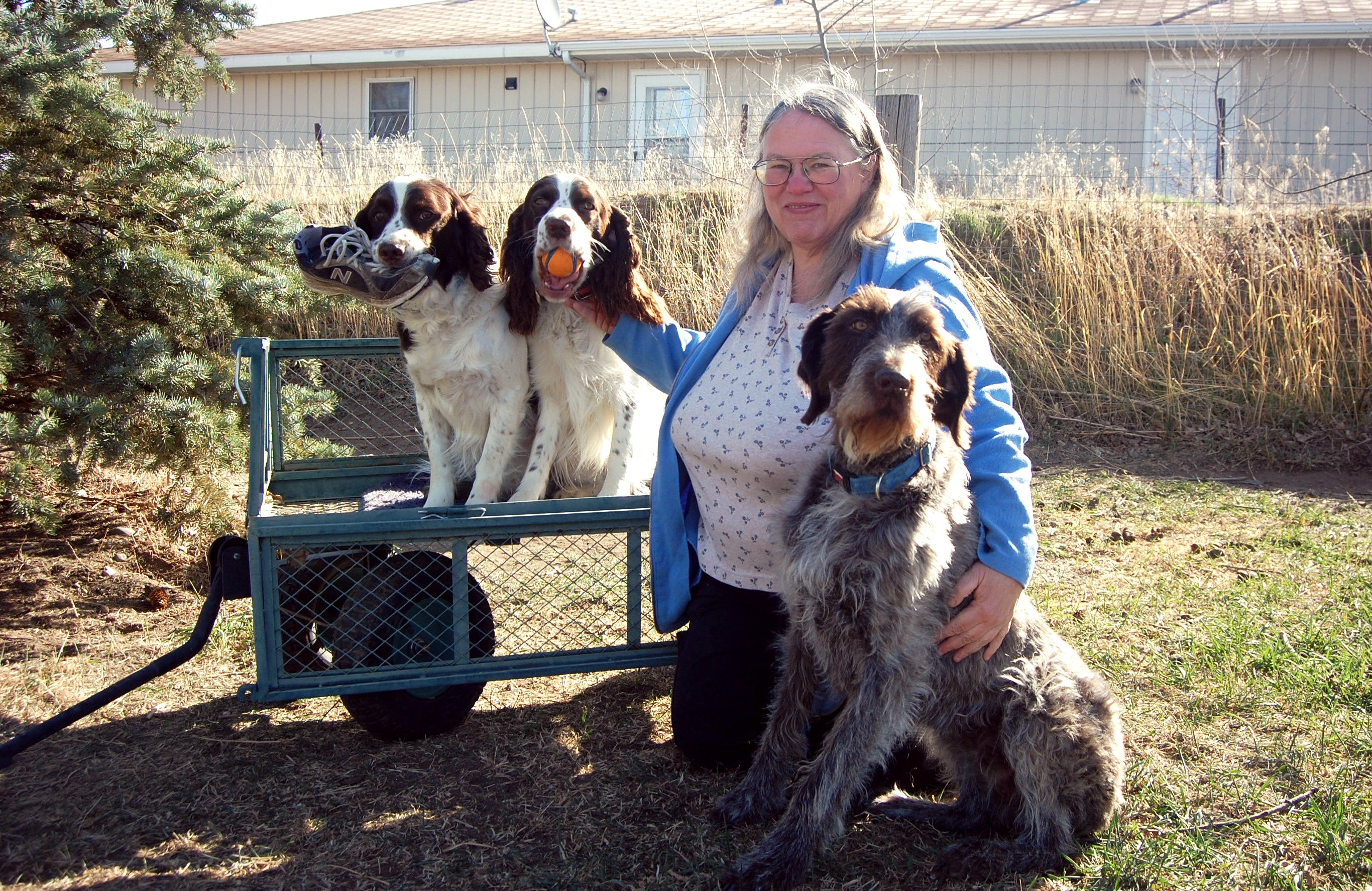 Team member Deana with her three dogs