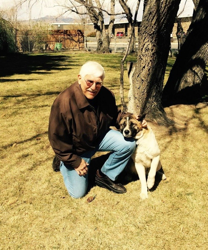 Team member Dr. Blessings with his dog